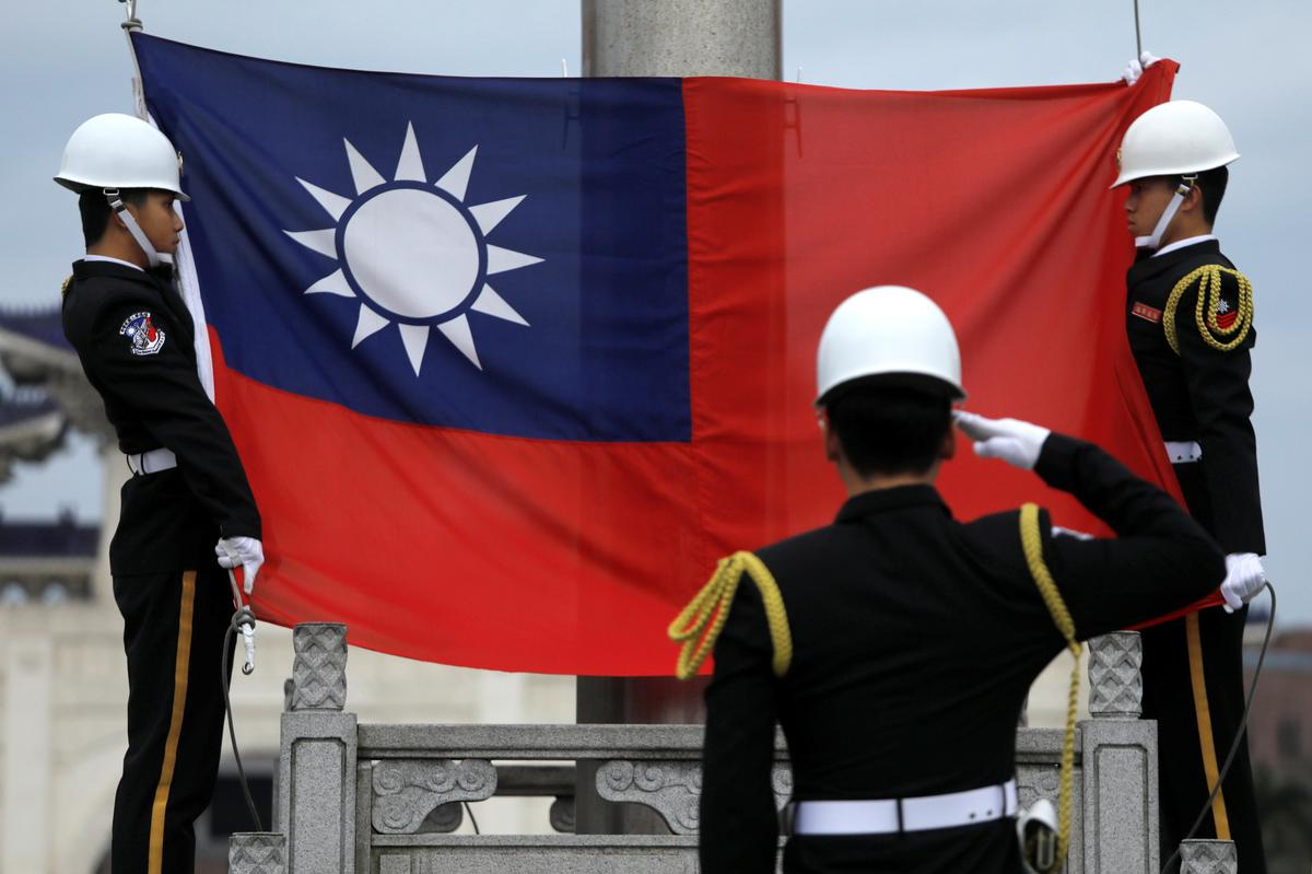 China offers more access for Taiwan firms, Taiwan warns of a trap