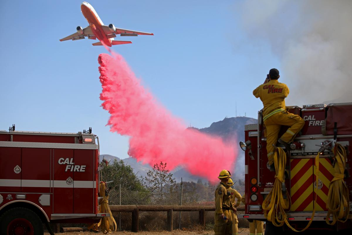 California blazes mostly contained as flame-fanning winds die down