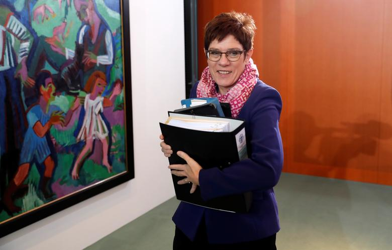 Germany's Kramp-Karrenbauer wants Merkel to stay...