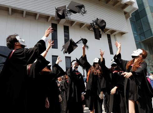Hong Kong students protest during graduation