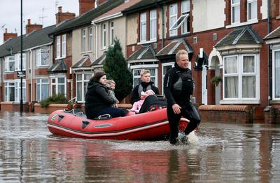 Downpours bring floods across central and northern England