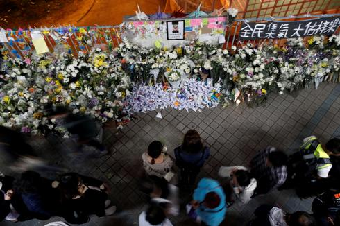 Hong Kong protesters mourn death of student