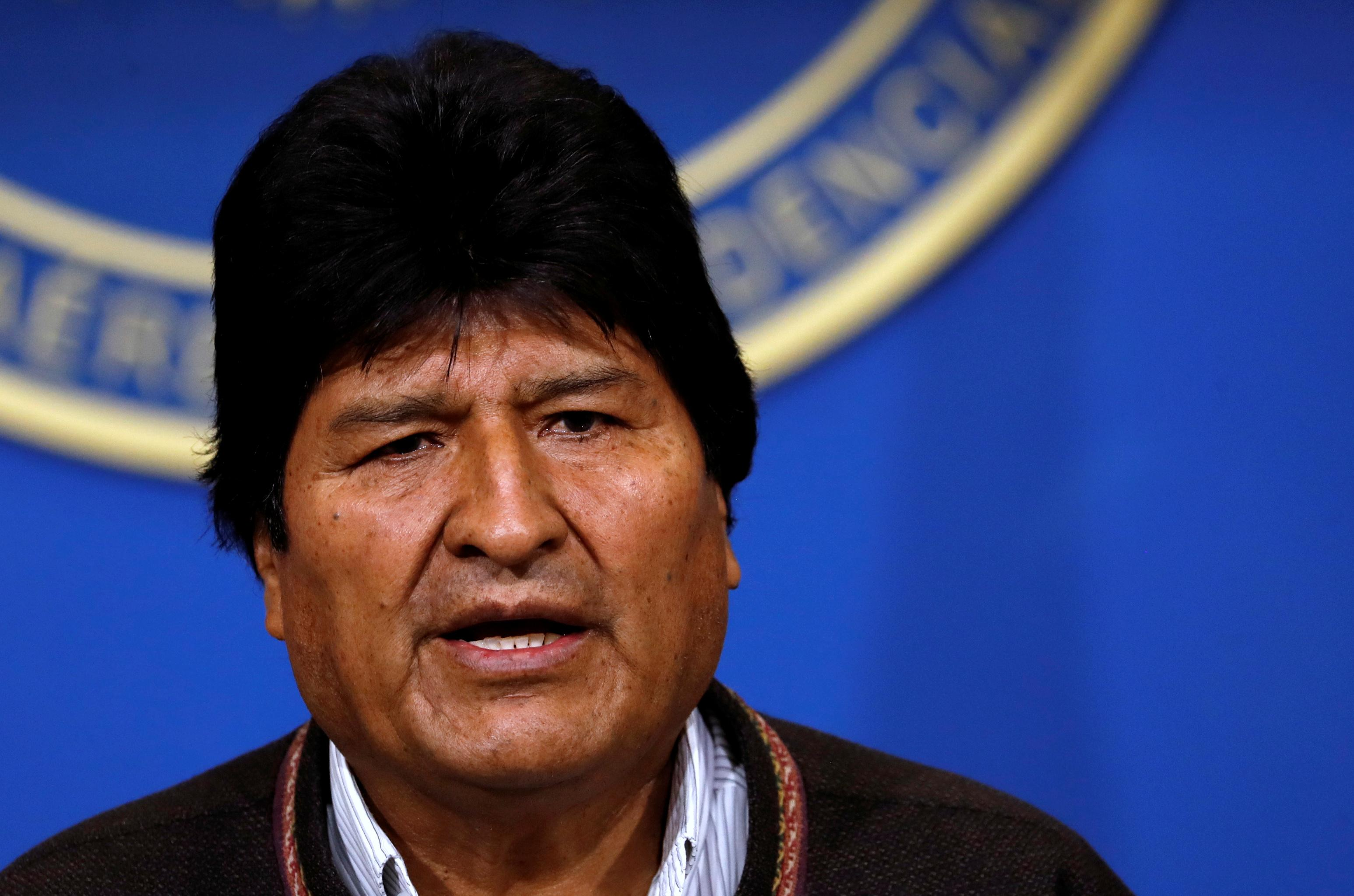 Bolivia's Morales resigns after protests, lashes out at 'coup'