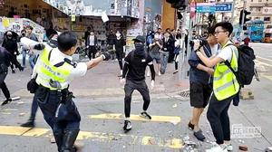 Hong Kong police officer shoots protester as violence flares