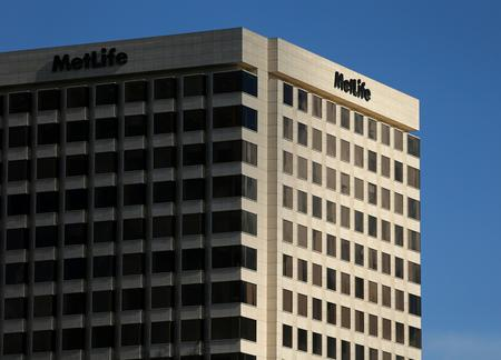 UPDATE 1-MetLife sued for gender discrimination by ex-chief administrative officer