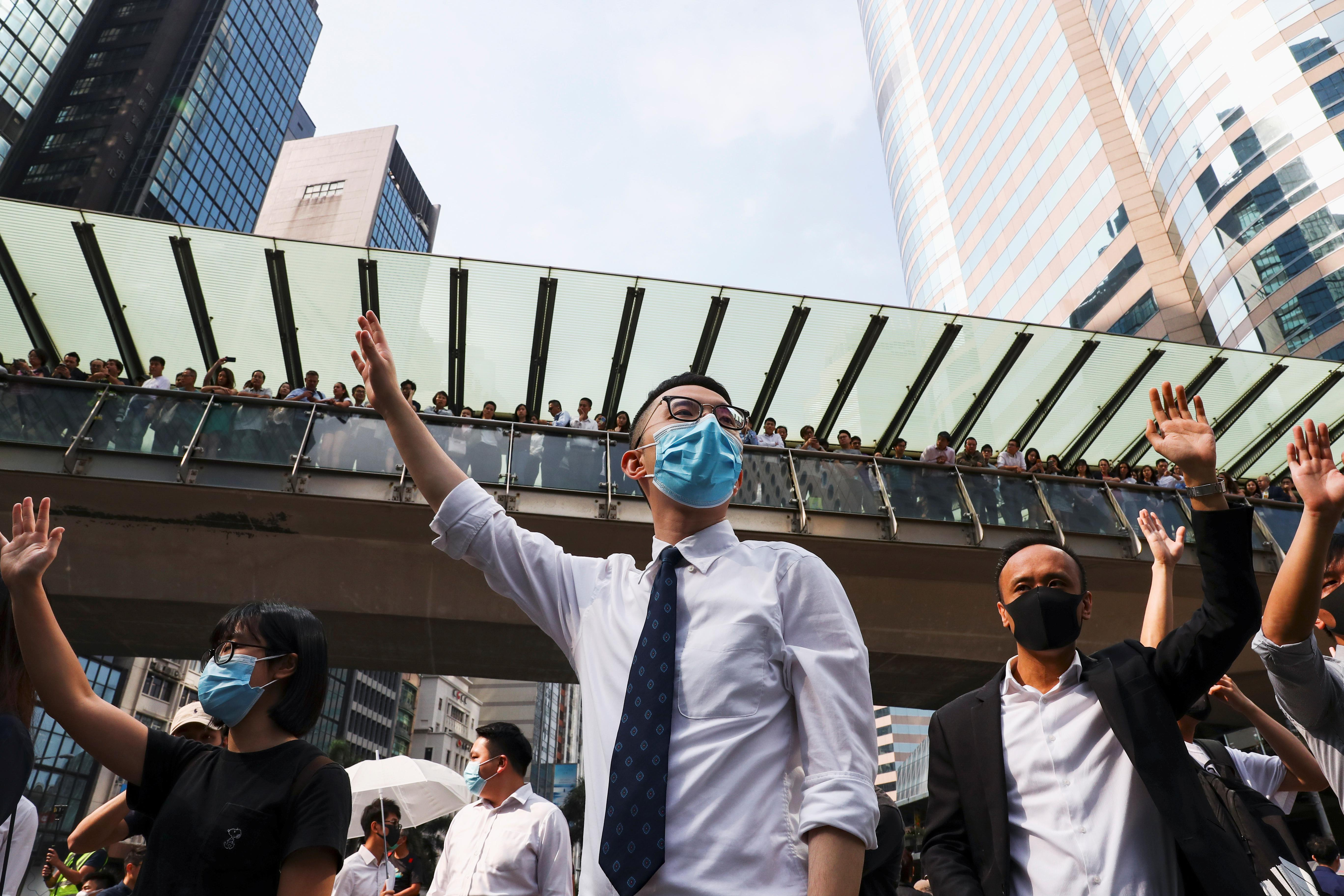 Schools close as protesters occupy Hong Kong roads and campuses