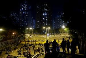Protesters and police battle at Hong Kong university campuses