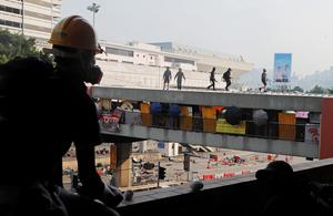 Protesters barricade Hong Kong university campuses