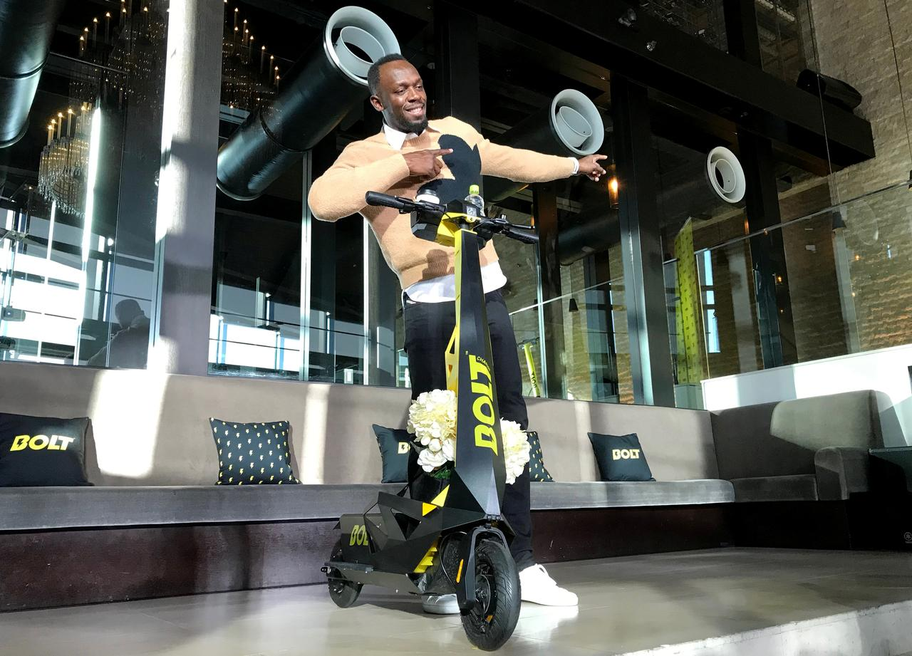 Image result for Usain Bolt scoots around rules to bring e-scooters to Japan""