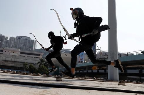Protesters barricade Hong Kong university campuses