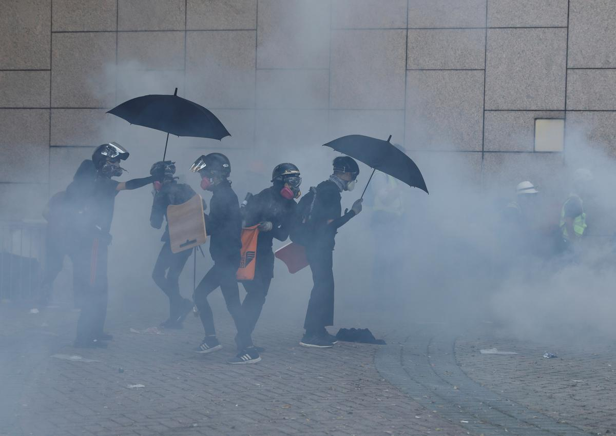 Hong Kong riot police fire tear gas near university campus