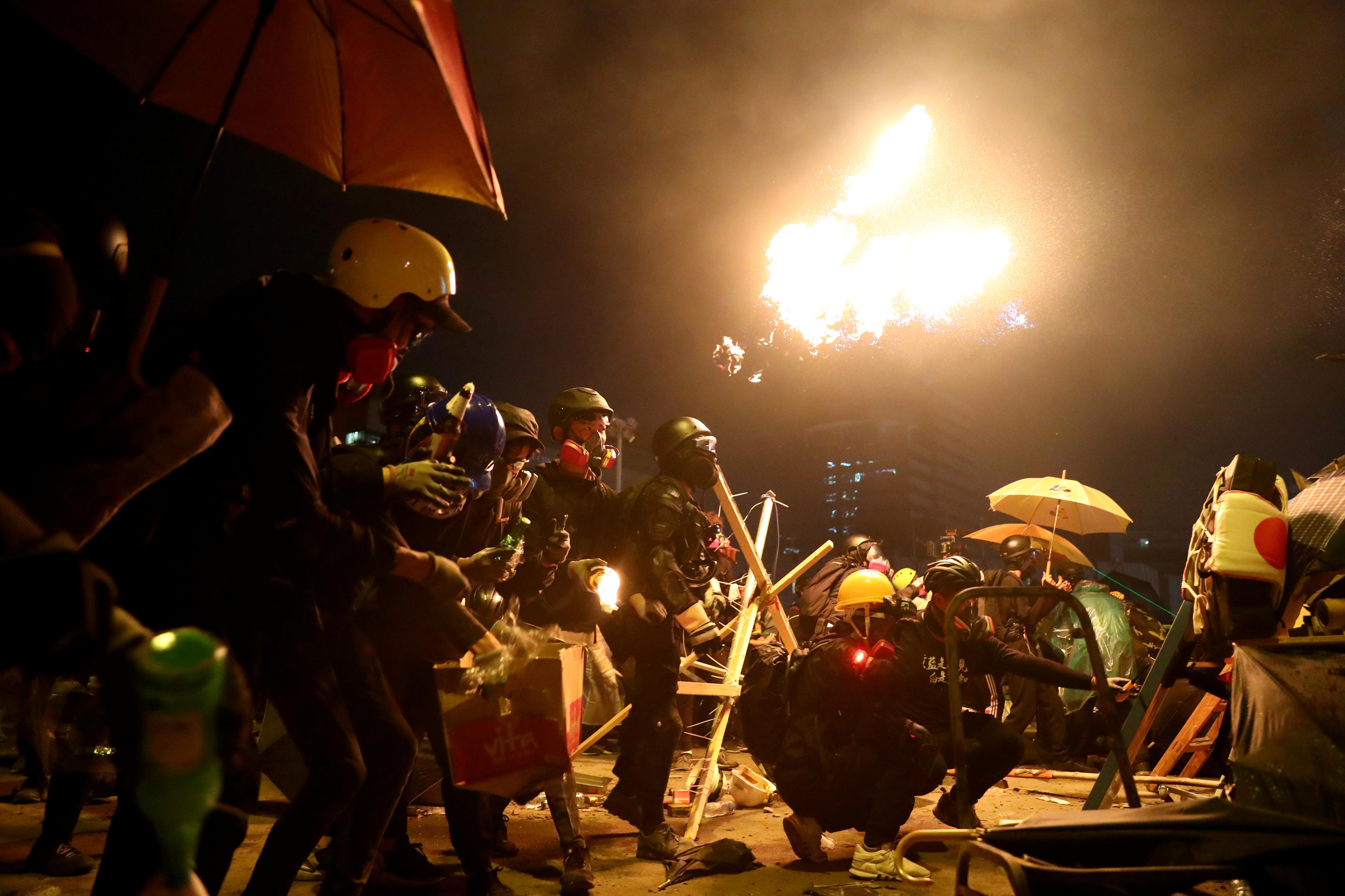 Hong Kong campus protesters fire arrows as anti-government unrest...
