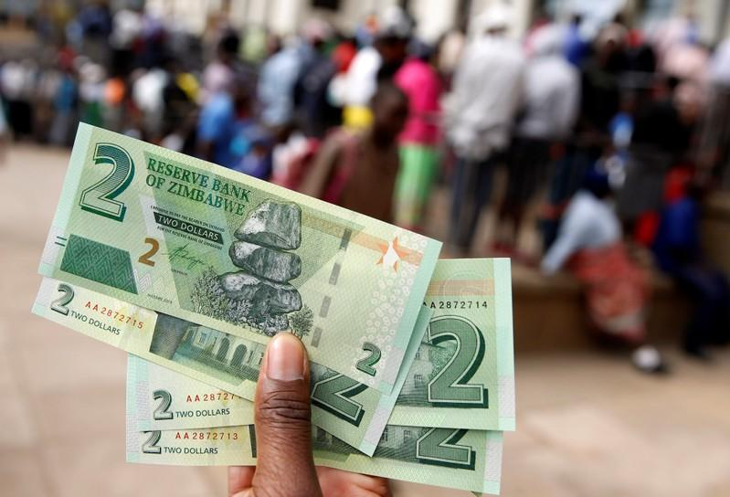 Zimbabwe central bank cuts main lending rate to 35% from 70% -statement