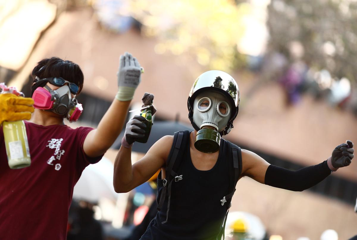 China says Hong Kong courts have no power to rule on face mask ban