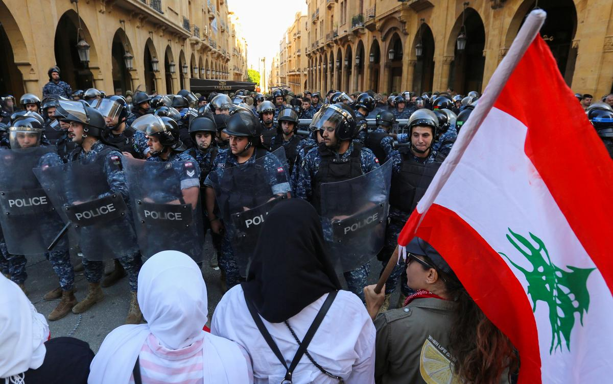 Protests force Lebanese parliament to postpone session; banks reopen