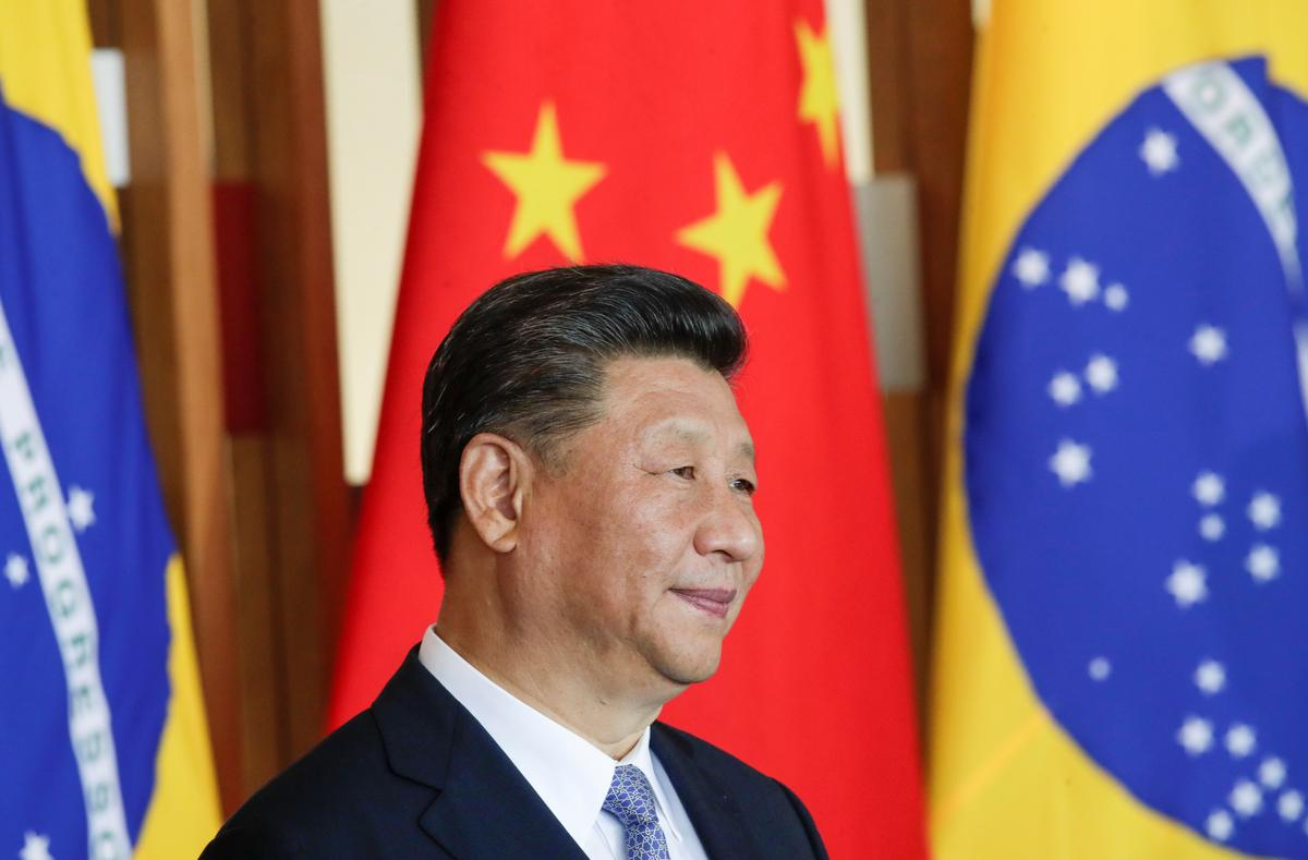 China's Xi says he wants to work out initial trade deal with U.S.