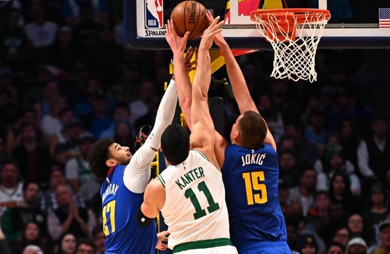 NBA roundup: Walker stretchered off as Celtics fall in Denver