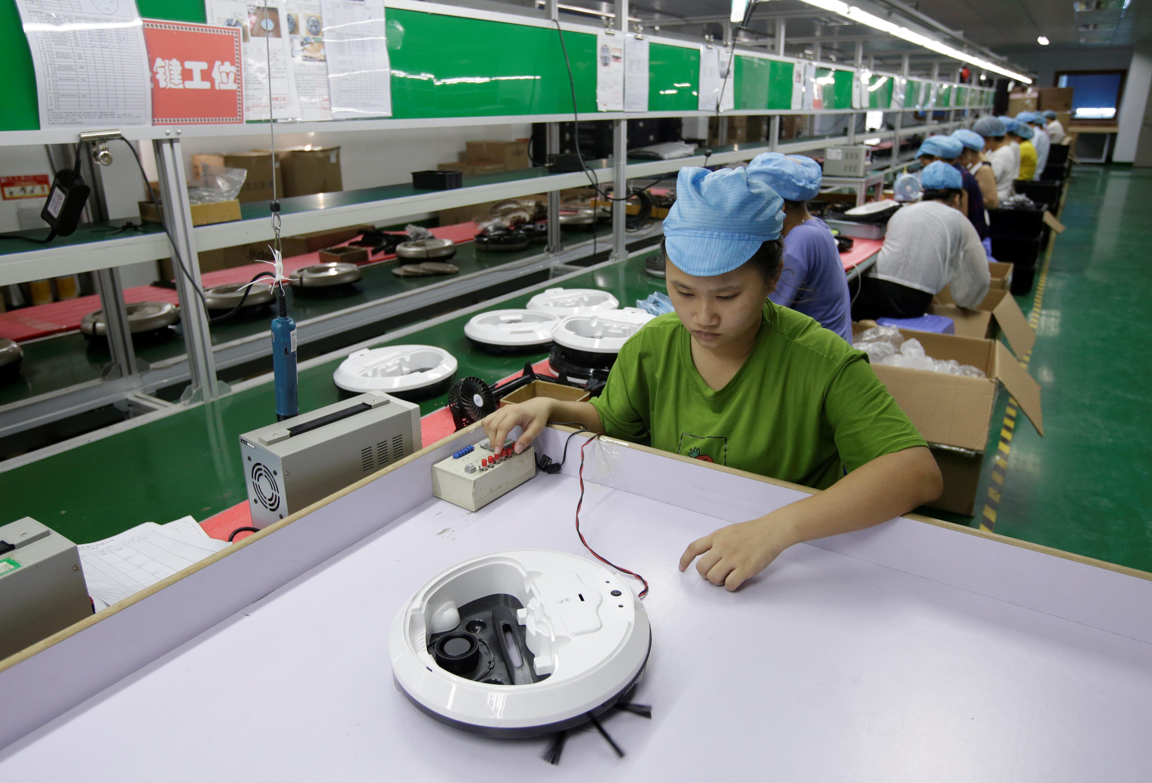 China's factory activity unexpectedly returns to growth in November