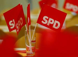 Flags with the logo of Bavaria's Social Democratic Party are seen prior to...