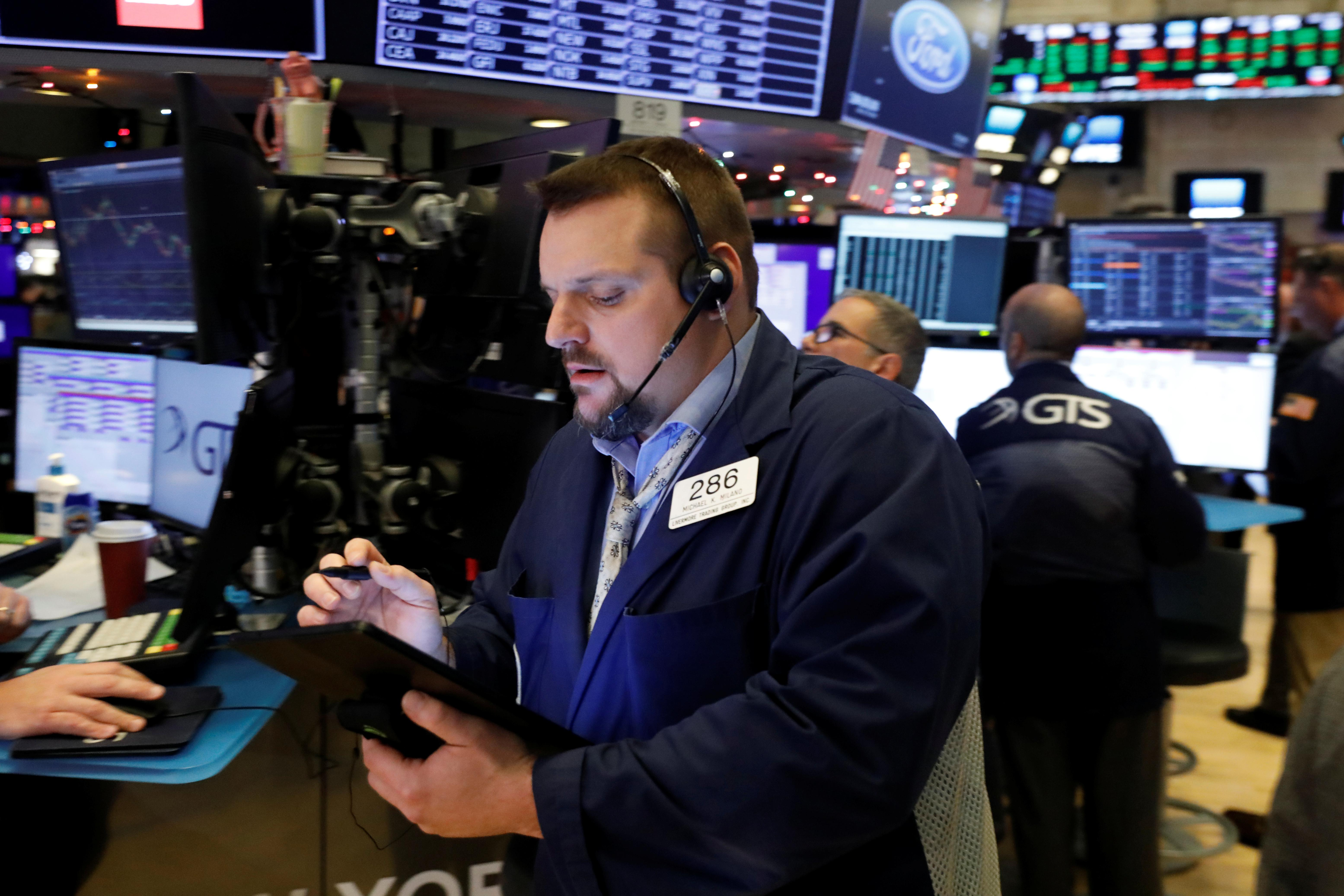 Wall Street advances on strong jobs report, trade optimism
