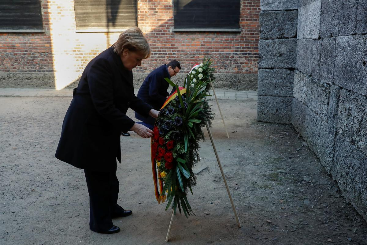 Merkel expresses 'shame' during Auschwitz visit, vows to fight...