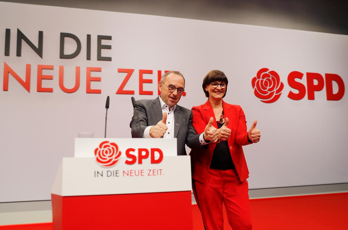 Germany's SPD backs new leaders' demands to stay in Merkel coalition
