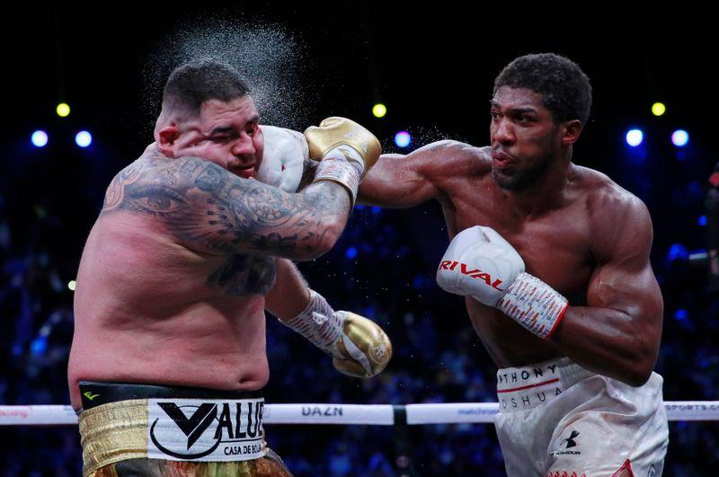Boxing: Joshua takes back heavyweight titles on unanimous points...