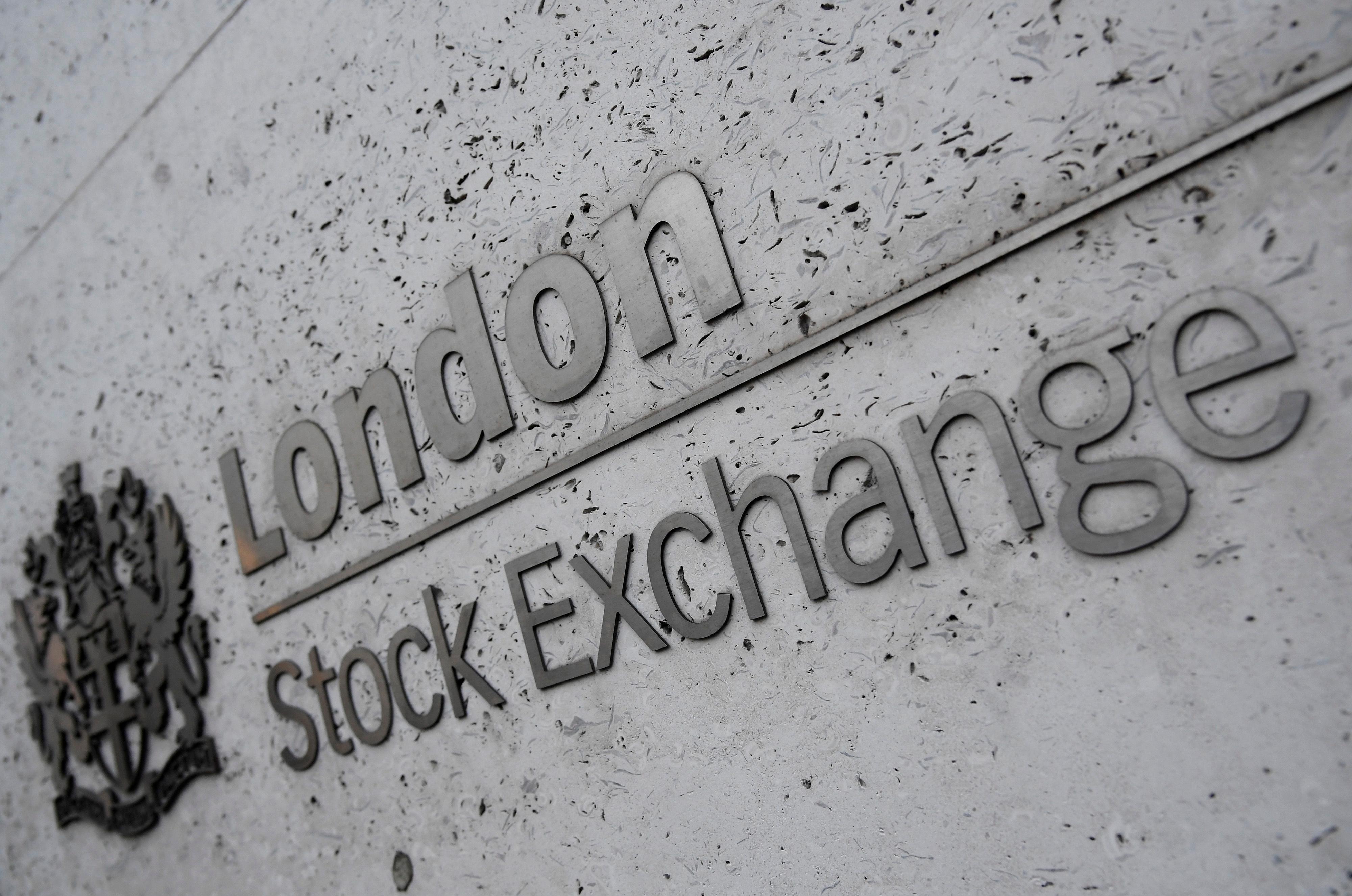 Global stocks, dollar slip as U.S.-China trade deadline looms