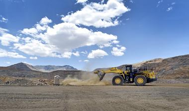 FILE PHOTO: A front-end loader is used to reinforce a safety berm inside...