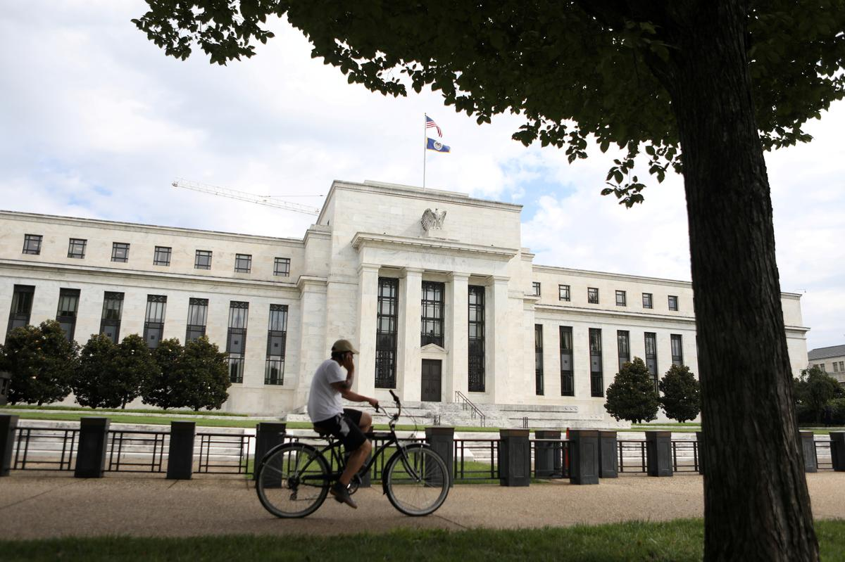 Fed stands pat on rates, expects no...