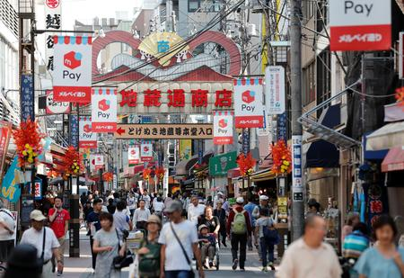 Japan tax revision targets corporate cashpile to spur spending, 5G investment