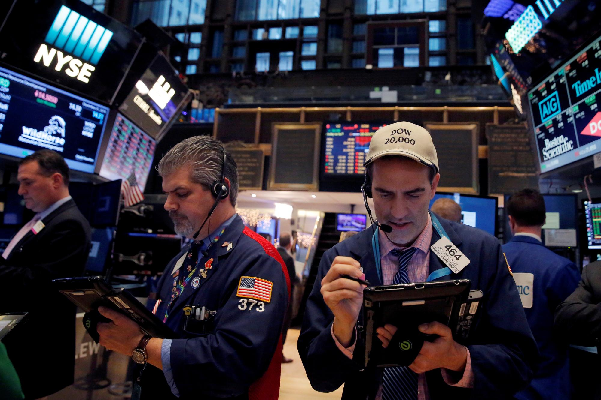 Wall Street touches record high on trade optimism