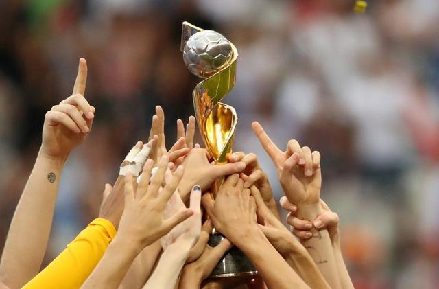 FILE PHOTO: Soccer Football - Women's World Cup Final - United States v Netherlands - Groupama Stadium, Lyon, France - July 7, 2019 United States players celebrate winning the Women's World Cup with the trophy REUTERS/Denis Balibouse/File Photo