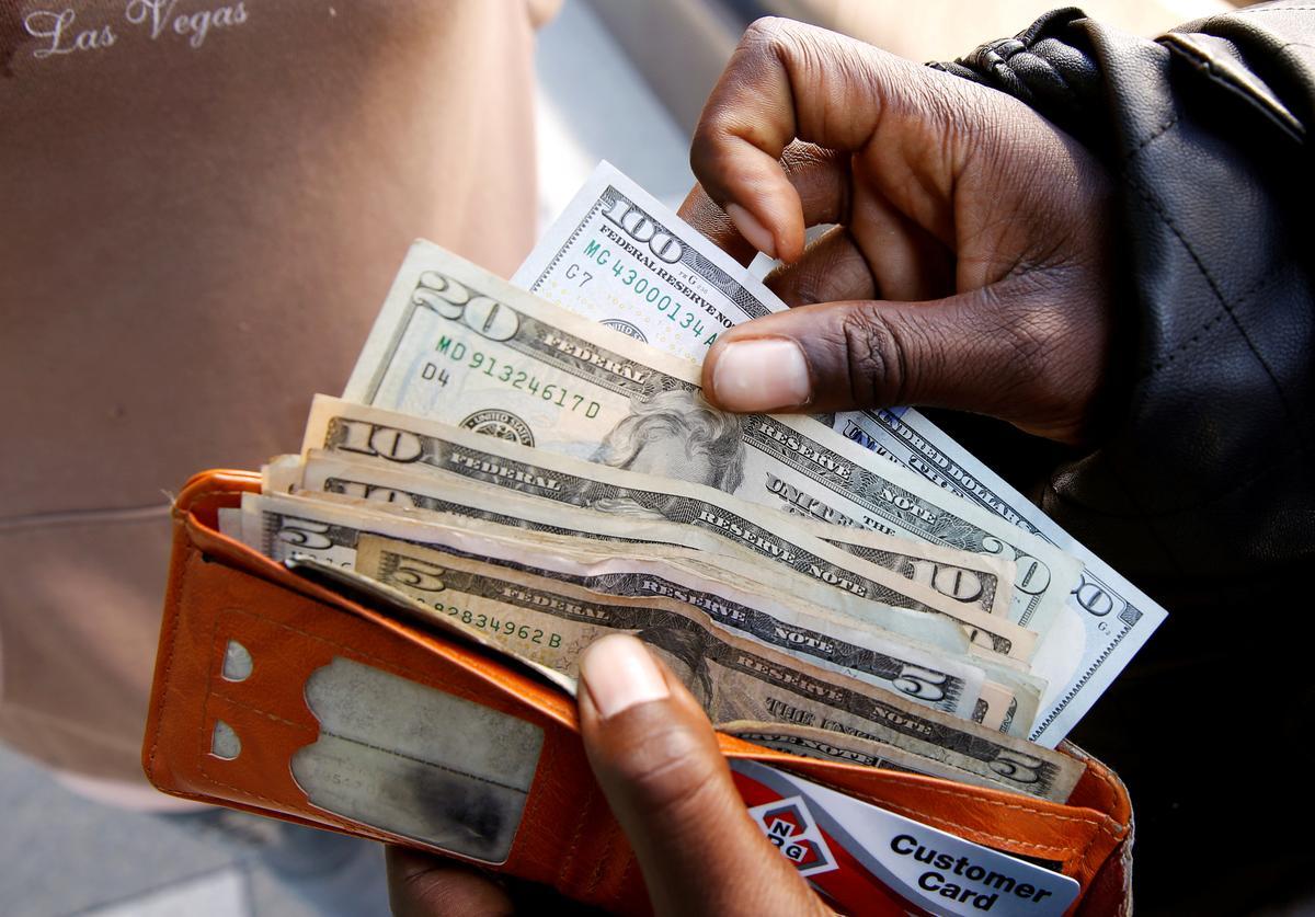 Dollar eases, on track for smallest return in 6 years as risk appetite revives