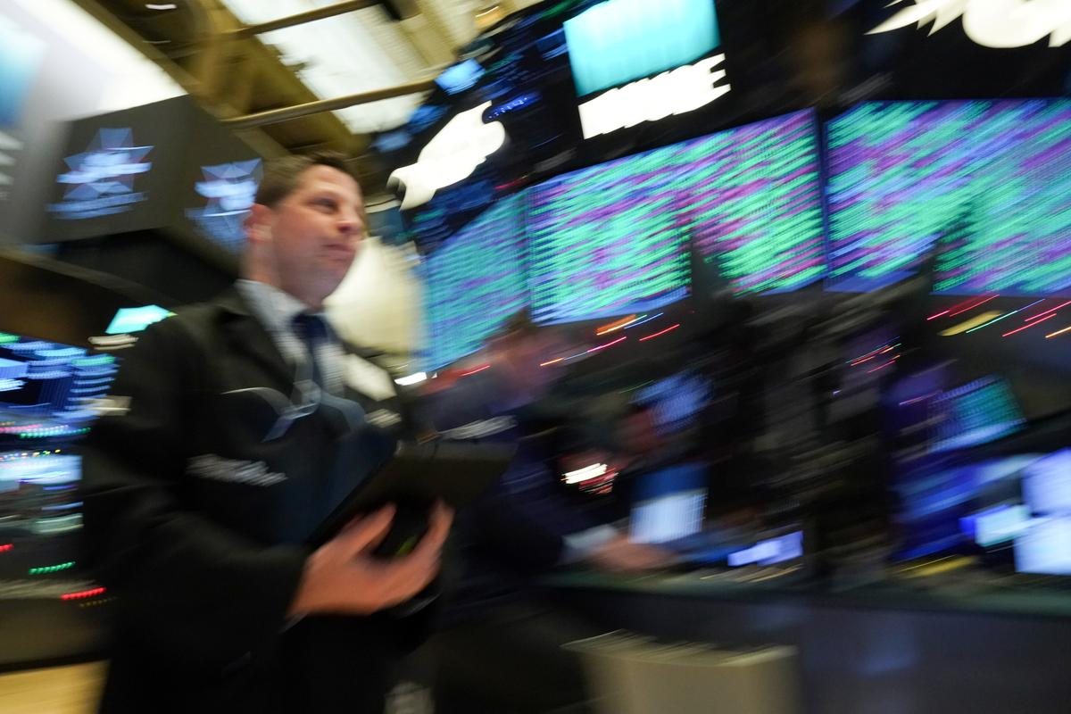 Global stocks hit record as rally enters new year, dollar rebounds