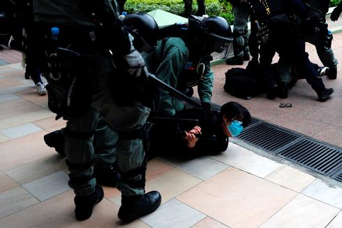 Dozens arrested after Hong Kong protesters take aim at Chinese traders