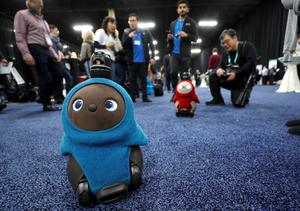 Lovot companion robots by Groove X wander in front their booth at CES Unveiled during the 2020 CES in Las Vegas, Nevada, January 5, 2020. REUTERS/Steve Marcus