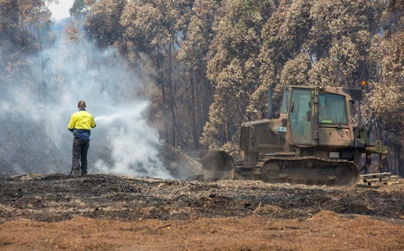 Australian prime minister's approval rating slumps as bushfires rage