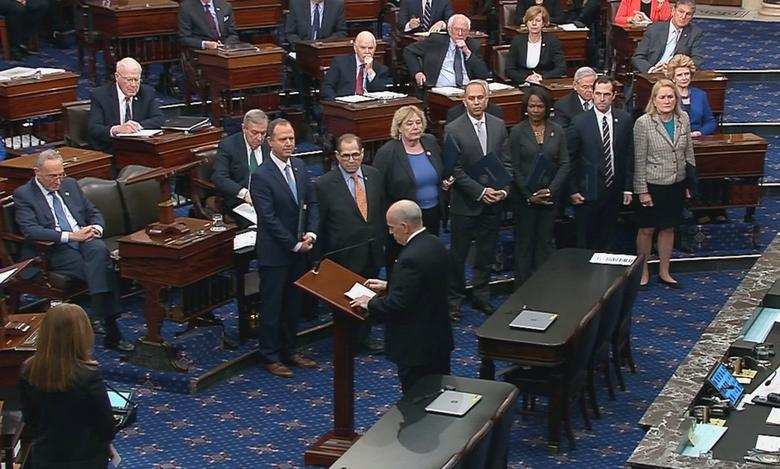 The Senate Sergeant at Arms Michael Stenger introduces the House impeachment managers, including lead manager House Intelligence Committee Chairman Adam Schiff (D-CA); House Judiciary Committee Chairman Jerrold Nadler (D-NY); Rep. Zoe Lofgren (D-CA); House Democratic Caucus Chairman Hakeem Jeffries (D-NY); Rep. Val Demings (D-FL); Rep. Jason Crow (D-CO) and Rep. Sylvia Garcia (D-TX) on the floor of the Senate as they arrive for the procedural start of the Senate impeachment trial of President Donald Trump in this frame grab from video shot at the Capitol in Washington, January 16, 2020. REUTERS/U.S. Senate TV/Handout via Reuters
