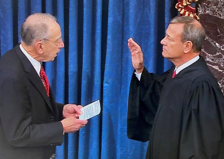 Senator Chuck Grassley (R-IA), the president pro tempore of the Senate, swears in Supreme Court Chief Justice John Roberts to preside over the Senate impeachment trial of President Donald Trump in this frame grab from video shot in the Senate Chamber at the U.S. Capitol in Washington, January 16, 2020. REUTERS/U.S. Senate TV/Handout via Reuters
