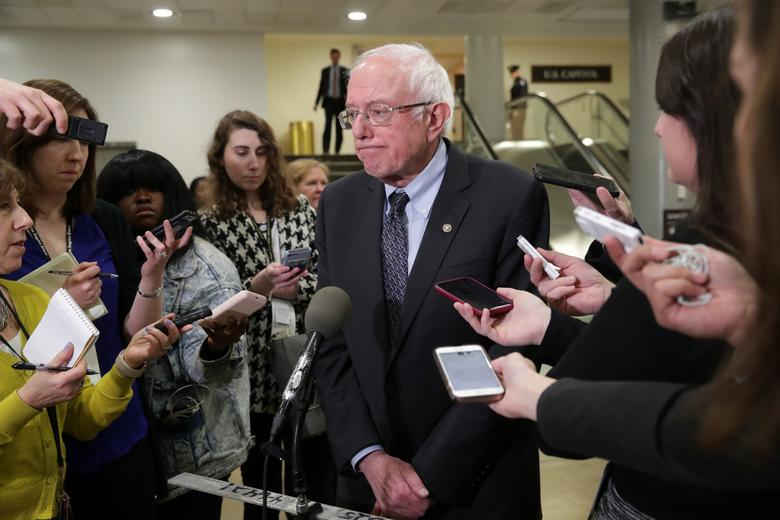 Democratic U.S. presidential candidate Senator Bernie Sanders (I-VT) talks to reporters during a break in the procedural start of the Senate impeachment trial of President Donald Trump at the Capitol in Washington, January 16, 2020. REUTERS/Jonathan Ernst
