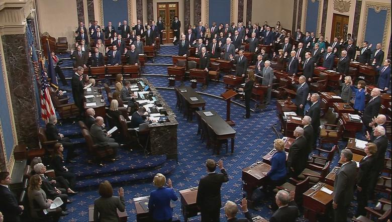 Chief Justice of the United States John Roberts swears in senators during the procedural start of the Senate impeachment trial of President Donald Trump in this frame grab from video shot in the Senate Chamber at the U.S. Capitol in Washington, January 16, 2020. REUTERS/U.S. Senate TV/Handout via Reuters