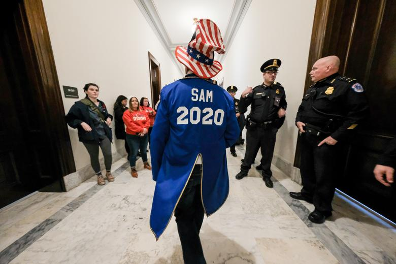 A demonstrator wearing a 'Sam 2020' jacket rallies outside of the office of Senator Mitchell McConnell calling on President Donald Trump inside of the Russell Senate Office Building during a demonstration on Capitol Hill in Washington, January 16, 2020. REUTERS/Michael A. McCoy