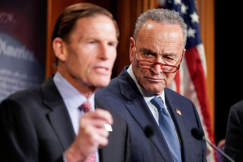 Senate Minority Leader Chuck Schumer (D-NY) listens as Senator Richard Blumenthal (D-CT) speaks to journalists after the beginning of the impeachment trial of President Donald Trump on Capitol Hill in Washington, January 16, 2020. REUTERS/Joshua Roberts