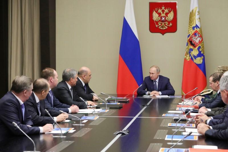 Putin speeds up Russian political shake-up, details new power center