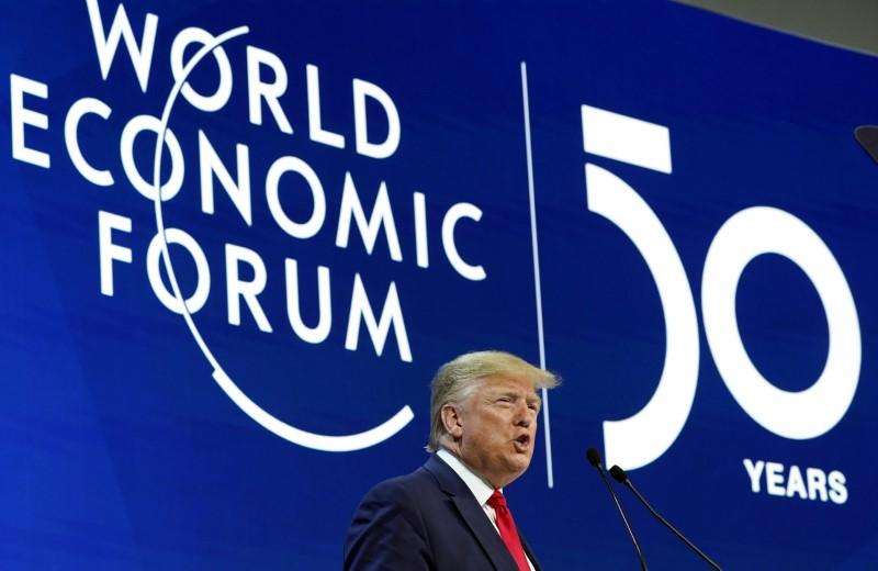 Trump touts U.S. economy, dismisses climate 'prophets of doom' as Greta looks on