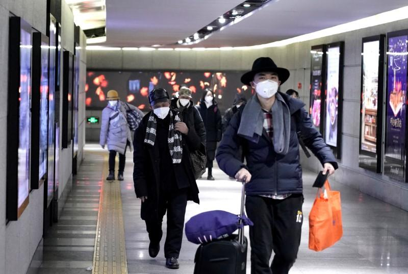 China companies issue staff with masks, travel warnings as virus outbreak fears grow