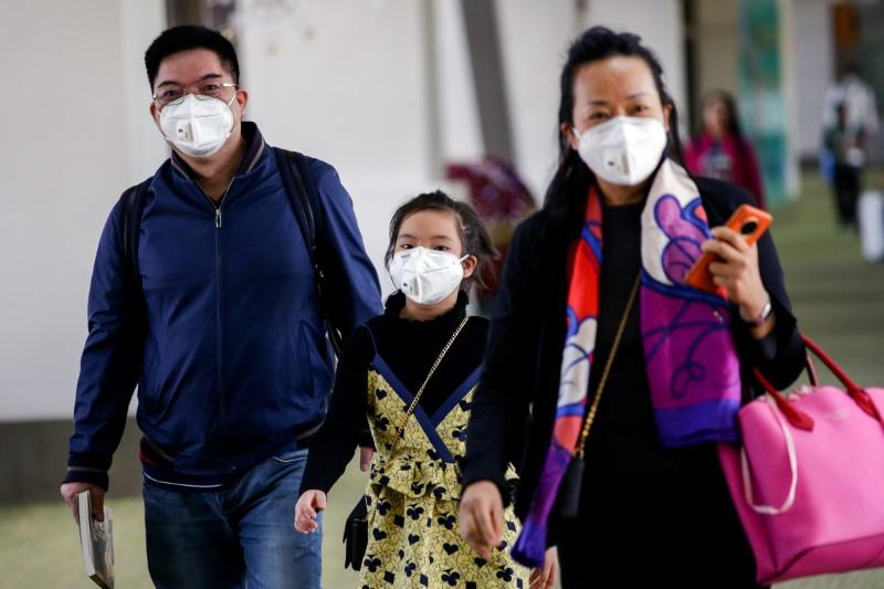 China's mask makers cancel holidays, jack up wages as new virus...