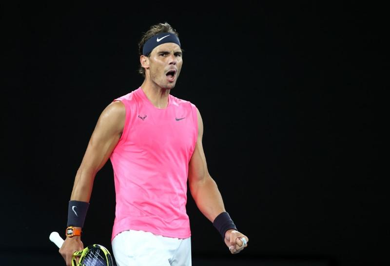 Sealed with a kiss, Nadal eases into third round in Melbourne