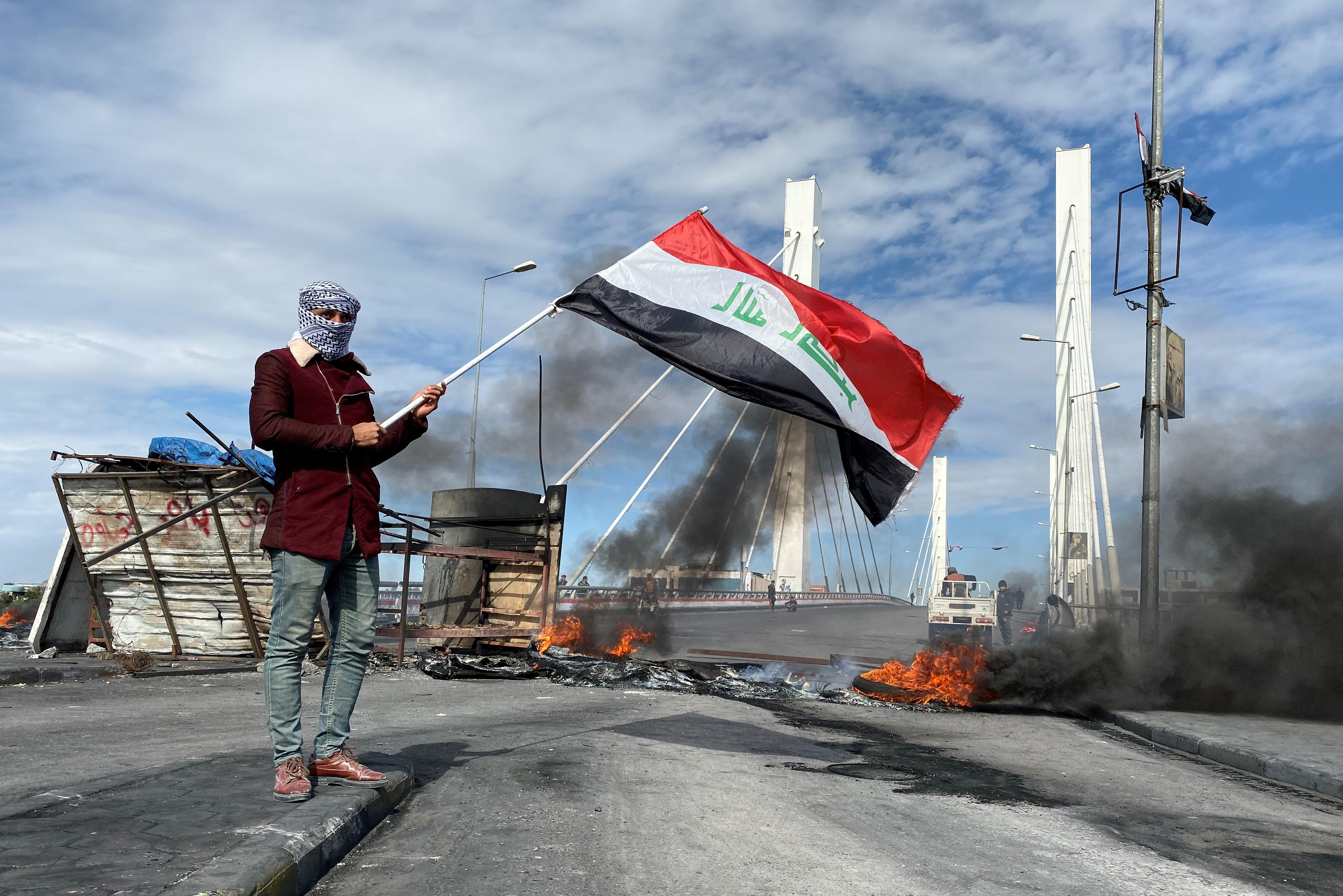 Iraqi security forces raid protest camps after Sadr supporters...